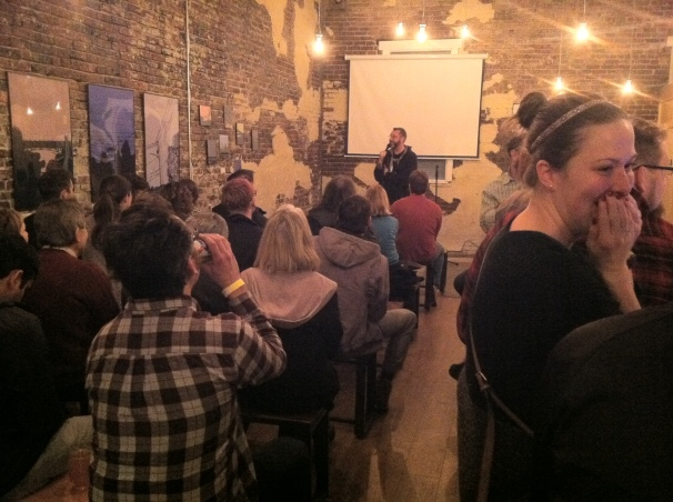 Night One: Greg Behrens (Atlanta) kicking off show one at Pretentious. That girl in the foreground speaks for all of us.