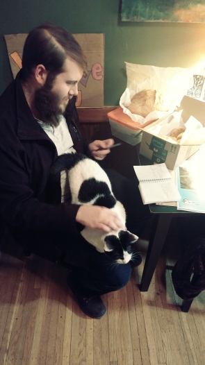 One of the two piebald house cats wouldn't leave Sean alone while he worked on his set list.